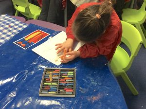 girl colouring in with chalk