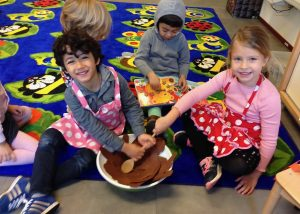 Early Years children making a 'Friendship Cake'